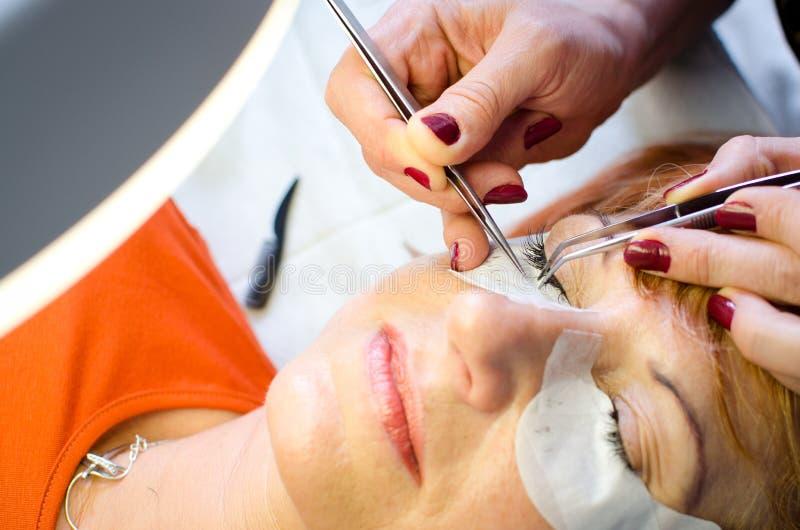 妇女睫毛引伸 图库摄影