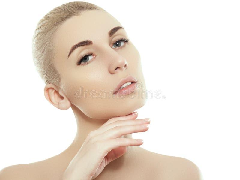 妇女秀丽在与健康皮肤的白色隔绝的面孔画象 库存照片