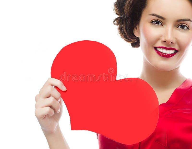 妇女秀丽红色心脏华伦泰` s爱 库存照片