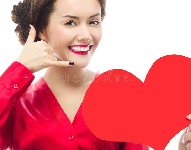 妇女秀丽红色心脏华伦泰` s爱 图库摄影