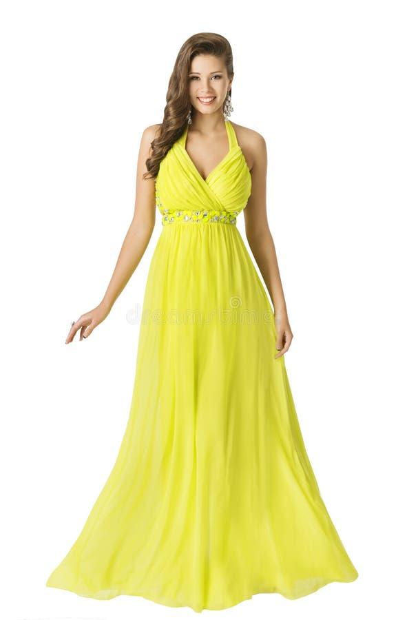 妇女秀丽长的时尚礼服,典雅的女孩黄色夏天褂子 库存照片