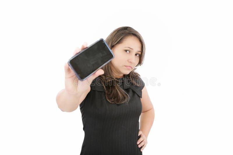 妇女移动电话显示显示  免版税库存照片