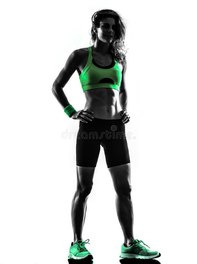 妇女站立剪影的健身锻炼 图库摄影
