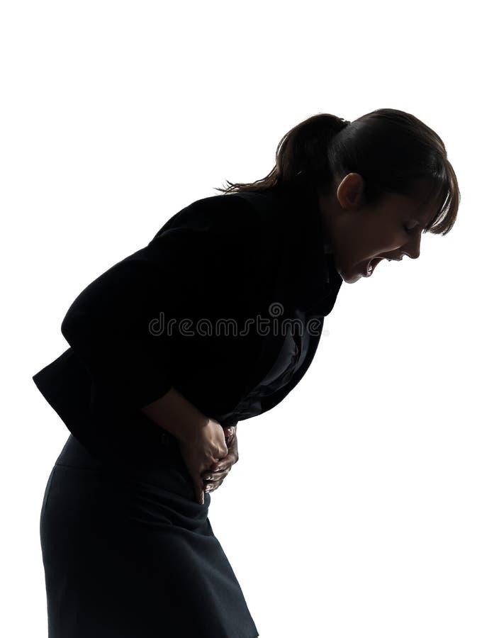 妇女胃痛抽疯剪影 免版税库存照片