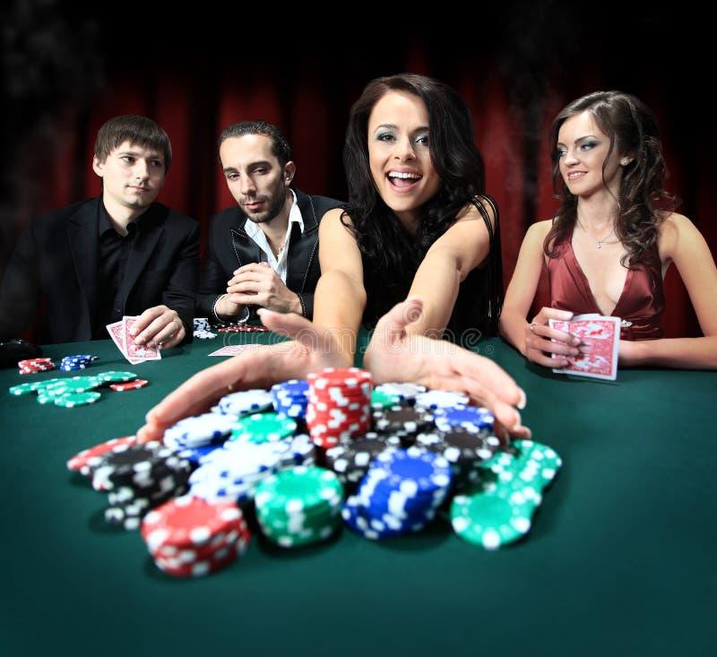 妇女胜利在赌博娱乐场 免版税库存照片
