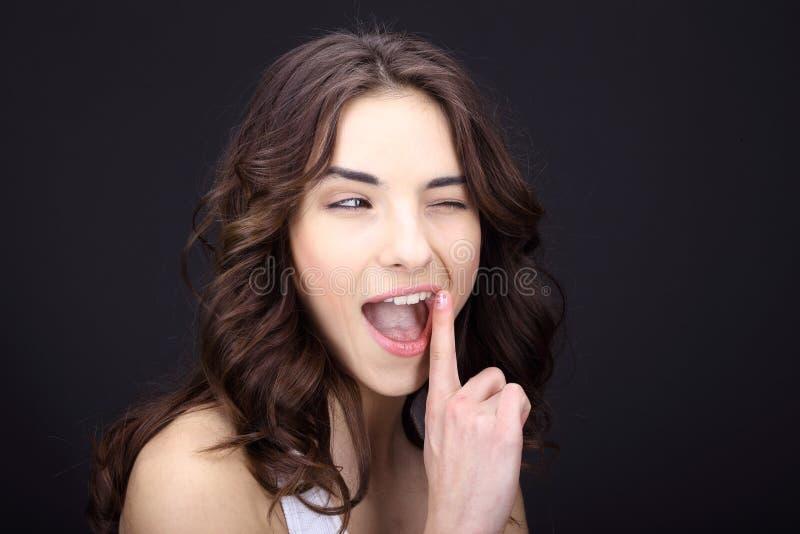 妇女请求沈默或秘密 免版税库存图片