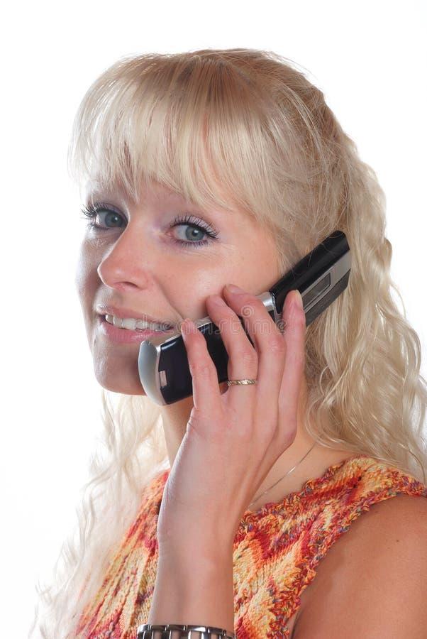 妇女谈话在轻碰电话 免版税库存图片