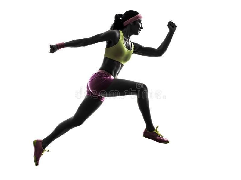 妇女赛跑者跑的跳跃的剪影 库存图片