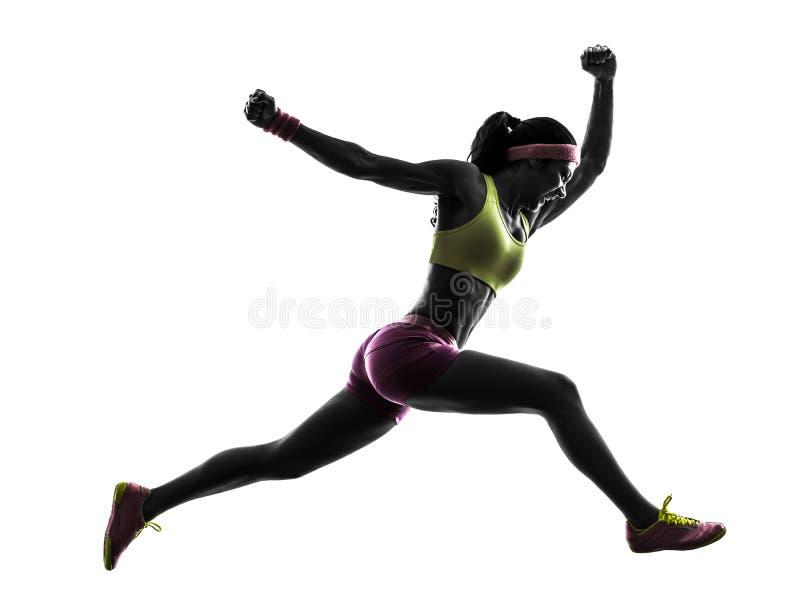 妇女赛跑者跑的跳跃的呼喊的剪影 图库摄影