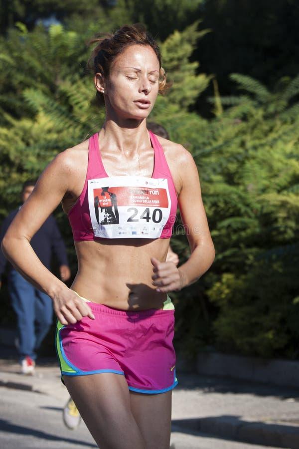 妇女赛跑(饥饿跑2014年, FAO/WFP) 库存照片
