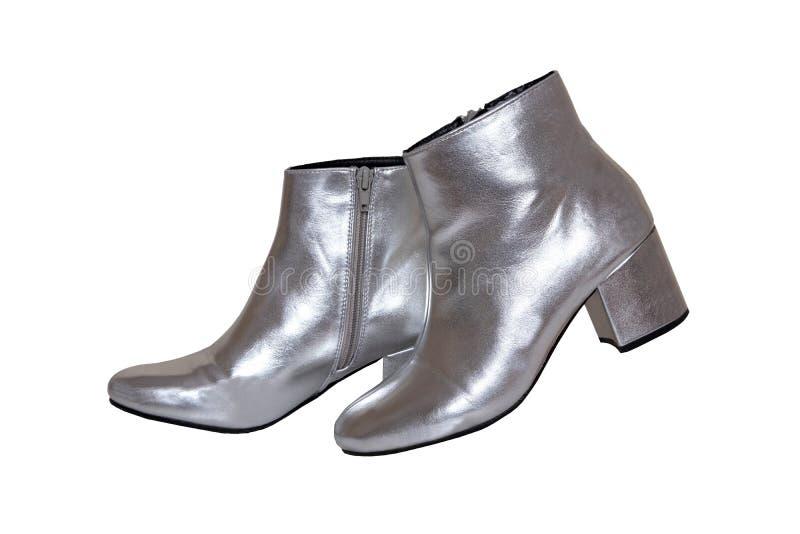 妇女起动和鞋子 一个在白色背景隔绝的对女性银色起动 皮鞋时尚新的收藏2019年 免版税库存图片