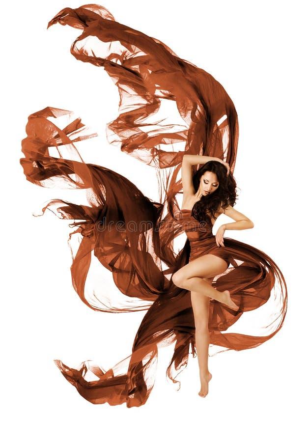 妇女跳舞织品飞行布料,时尚舞蹈家挥动的礼服 库存照片