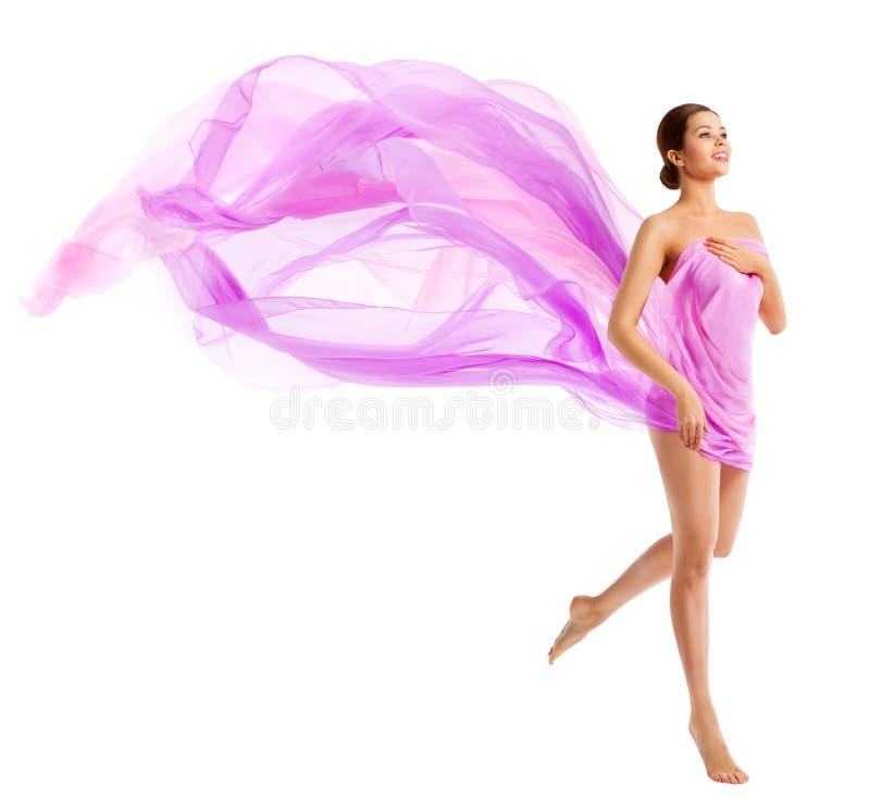 妇女身体秀丽,在挥动的丝织物布料的时装模特儿 图库摄影