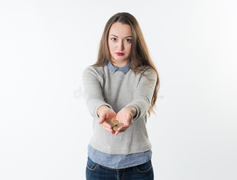 妇女递拿着欧洲硬币和给他们照相机 免版税库存照片