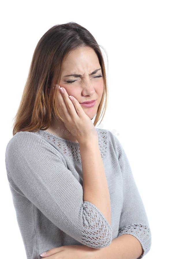 妇女遭受的牙痛用在面孔的手 免版税库存照片