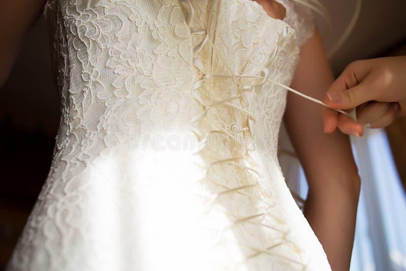 妇女鞋带婚礼礼服束腰 免版税库存照片