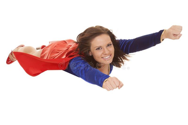 妇女飞行拳头微笑 库存照片