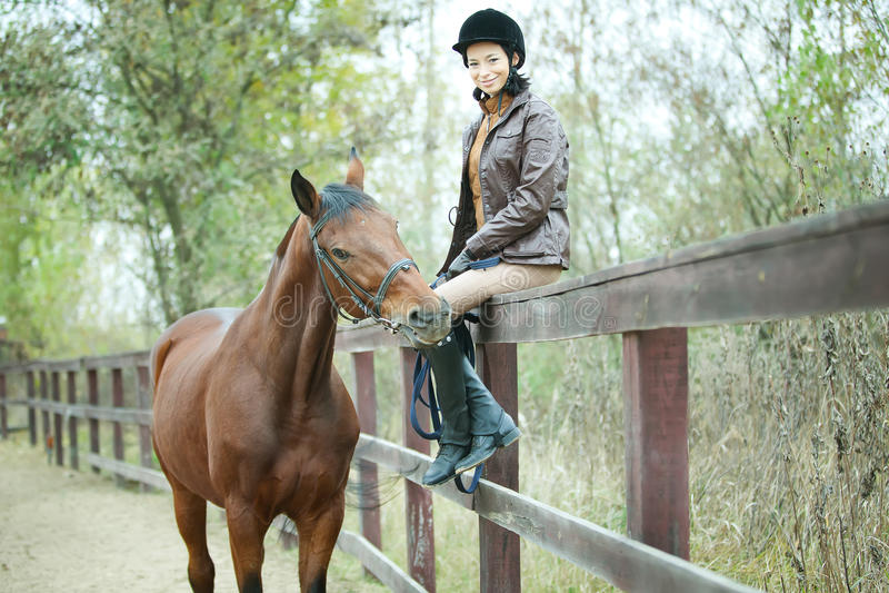 妇女骑师 免版税库存照片