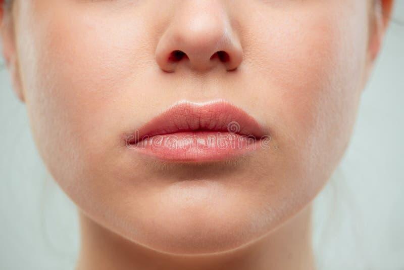 妇女嘴唇射击的关闭  免版税库存照片