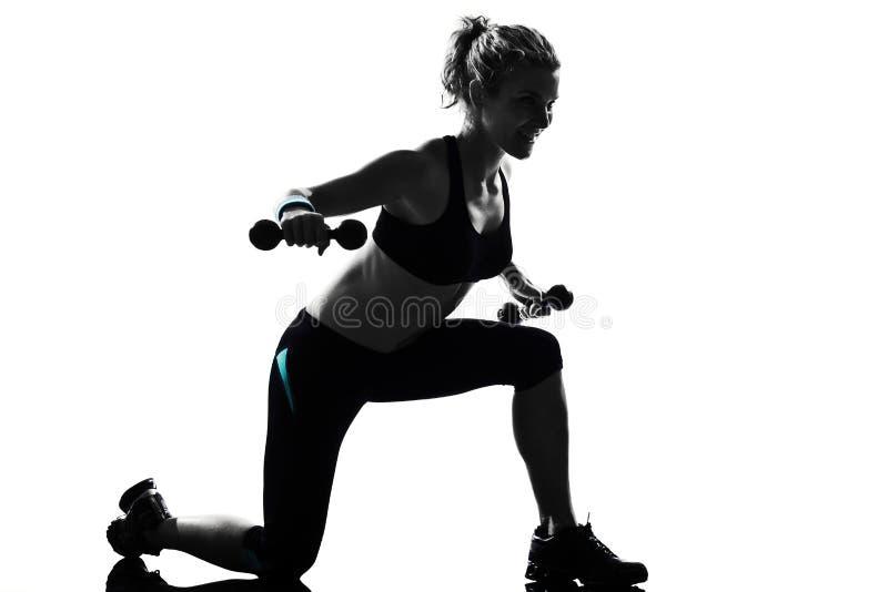 妇女锻炼健身姿势重量训练 库存图片