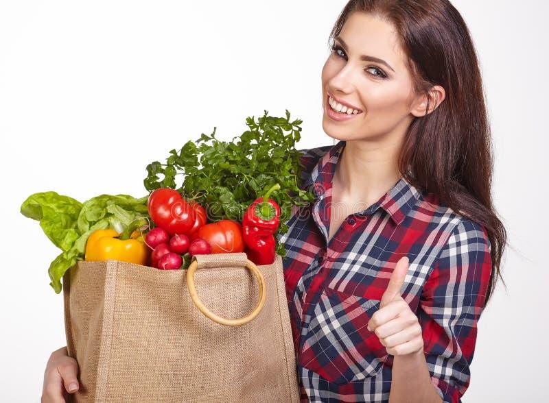 妇女购物袋菜 库存图片