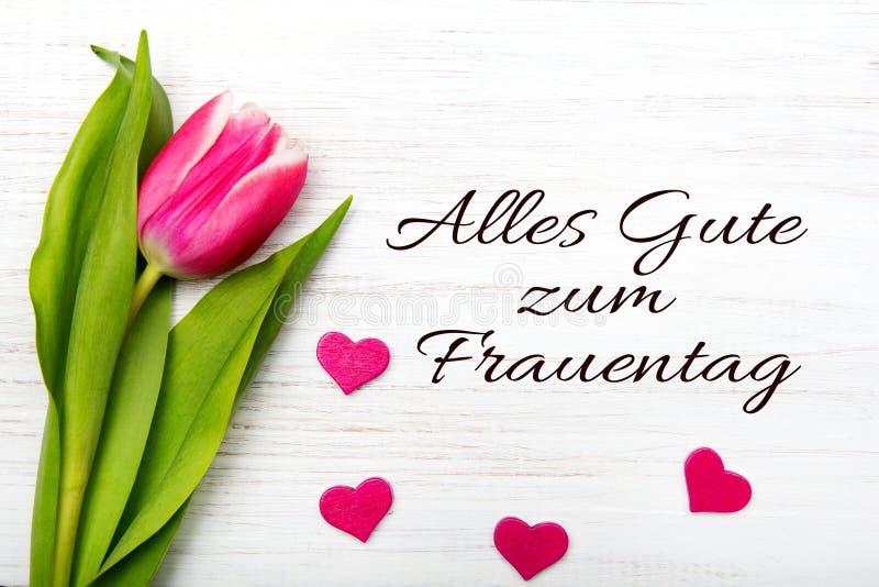 妇女` s与德语的天卡片措辞` Alles gute zum frauentag ` 免版税库存图片
