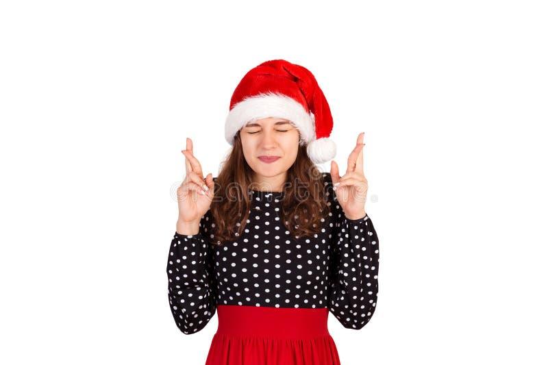 妇女withclosing的眼睛和举但愿的,当祈祷和希望从梦想实现时 情感女孩在圣诞老人ch 库存图片