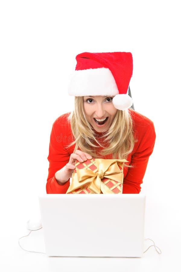 妇女Xmas在线购物 免版税库存照片