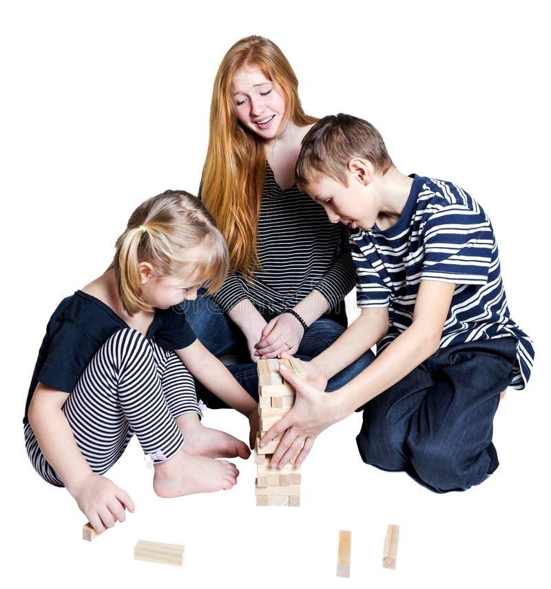 妈妈和两个孩子在白色背景一起使用 免版税图库摄影