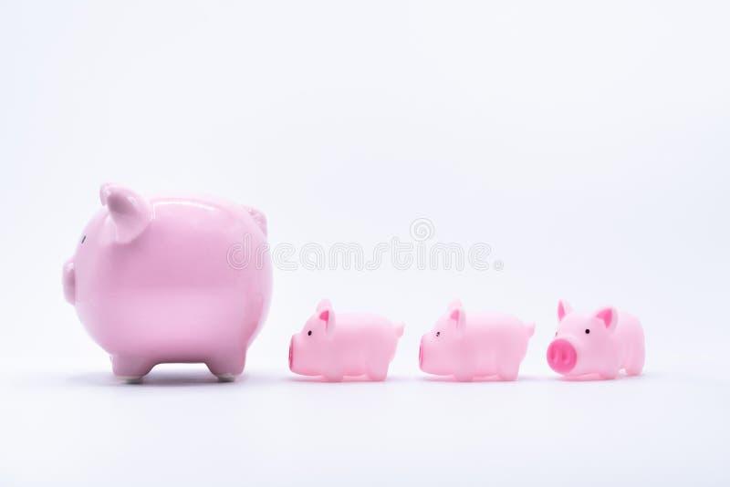 妈妈和婴孩存钱罐 免版税库存照片