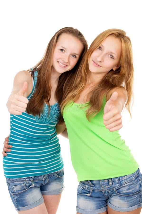 年轻姐妹展示标志ok 图库摄影