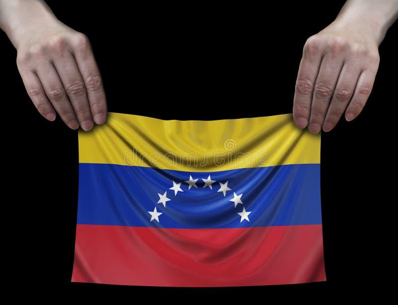 委内瑞拉旗子在手上 库存图片
