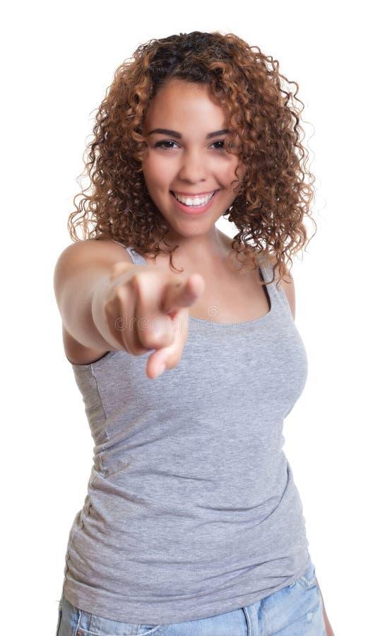 从委内瑞拉的笑的妇女指向照相机的 免版税库存图片
