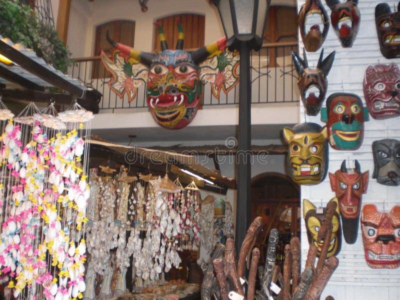 委内瑞拉节日庆祝典型的面具的陈列告诉了'恶魔快' 库存图片