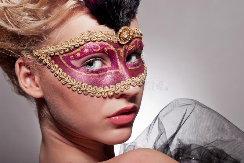 威尼斯式面具的美丽的妇女 库存照片