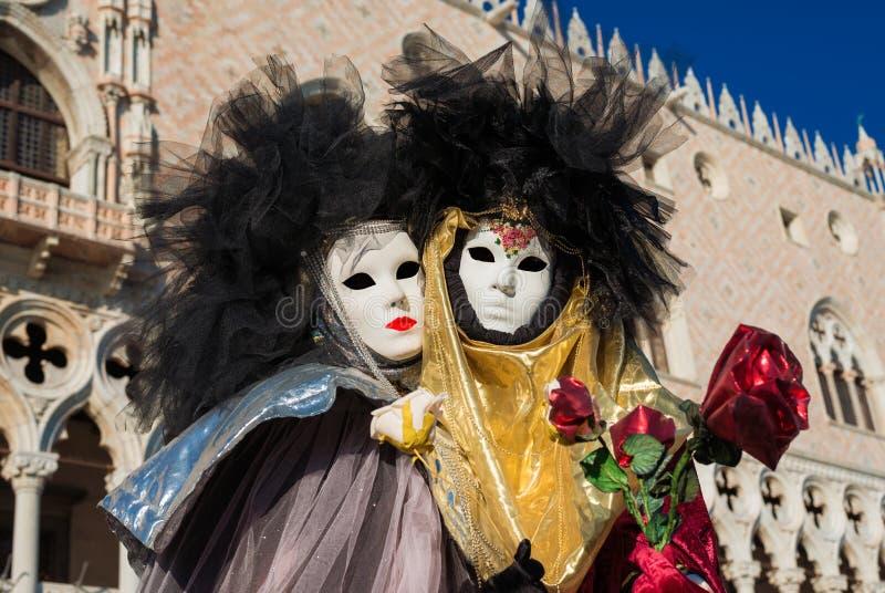 威尼斯狂欢节掩没与共和国总督宫殿 免版税库存图片