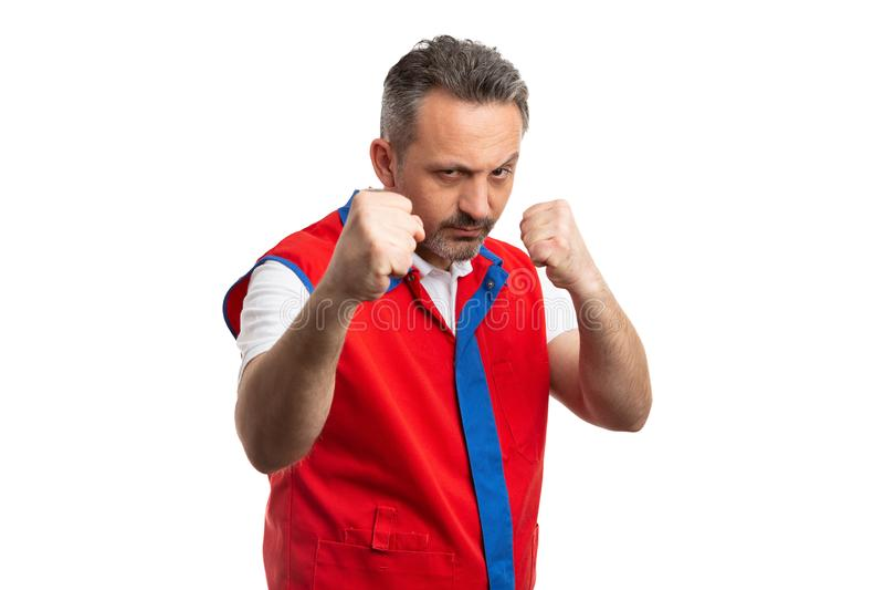 威胁与拳头的超级市场雇员 图库摄影
