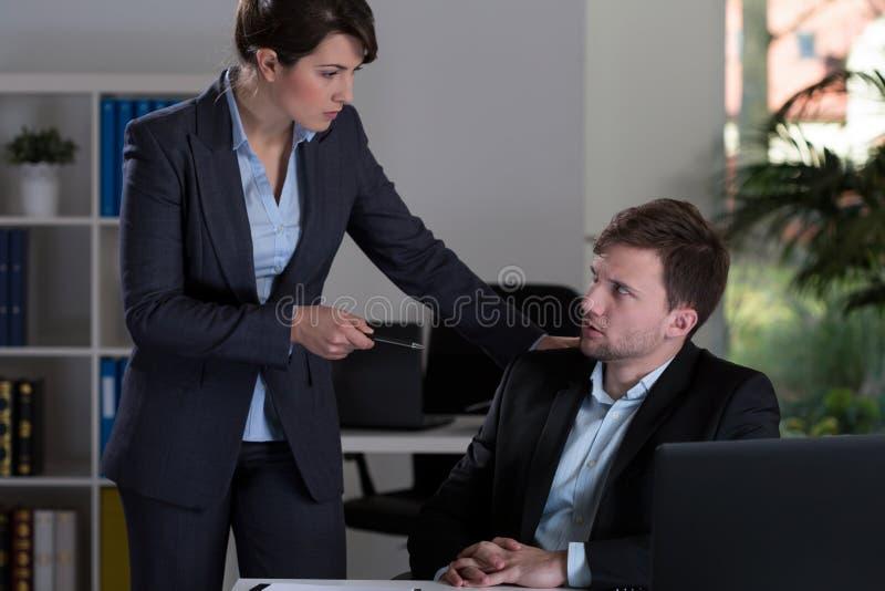 威胁在办公室 免版税库存照片