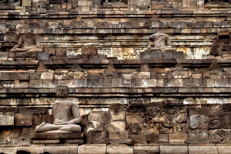 婆罗浮屠寺庙的片段 菩萨古老石雕象  印度尼西亚 免版税库存照片