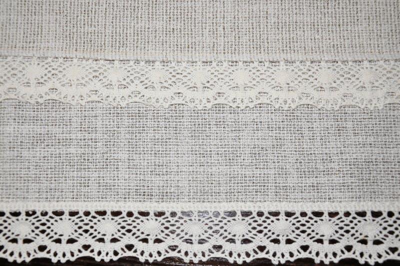 婚礼背景与有花边的丝带的古董纺织品 免版税库存图片