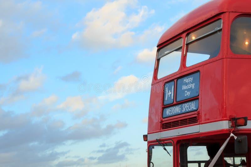 婚姻的专辑在伦敦红色双层公共汽车上 图库摄影