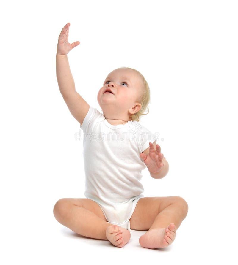 婴儿儿童小小孩坐的手 免版税库存图片