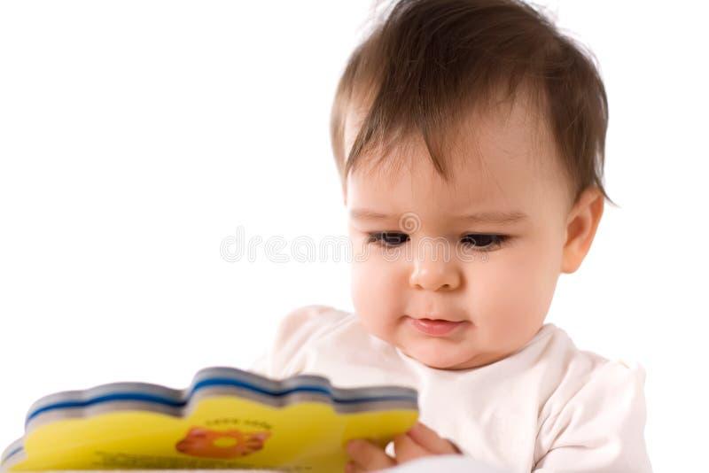 婴孩书女孩读取 免版税库存图片