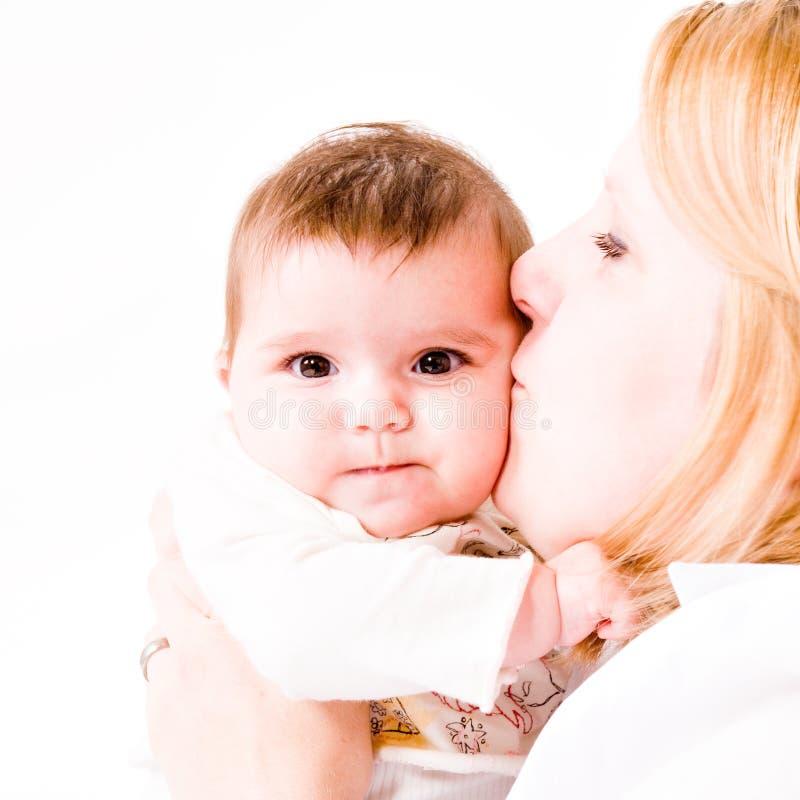 婴孩亲吻 库存照片