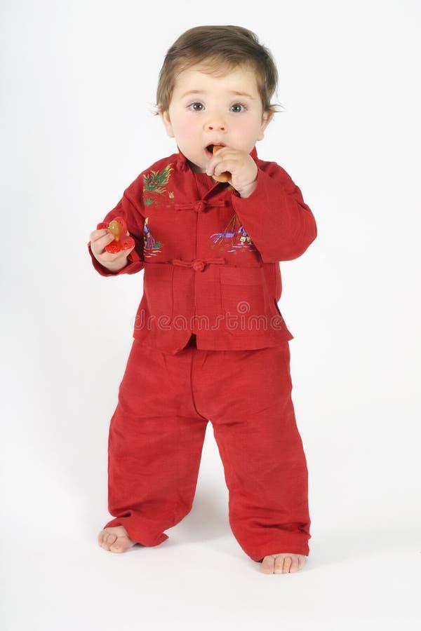 婴孩吃面包干身分 库存照片