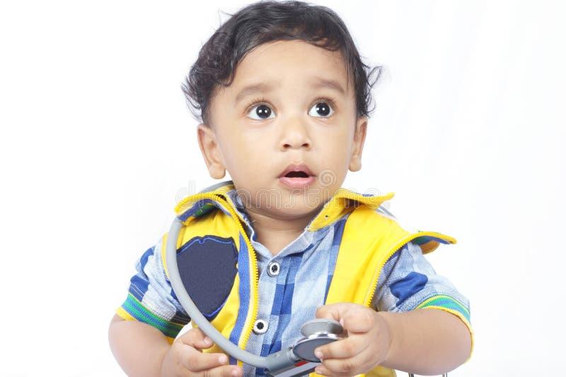 婴孩听诊器佩带 库存图片