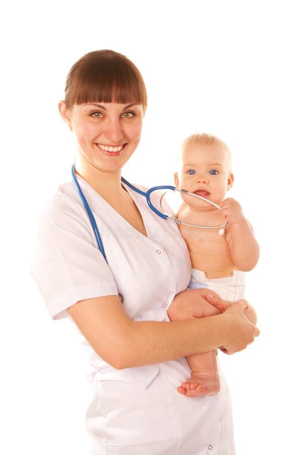 婴孩和医生使用。 免版税图库摄影