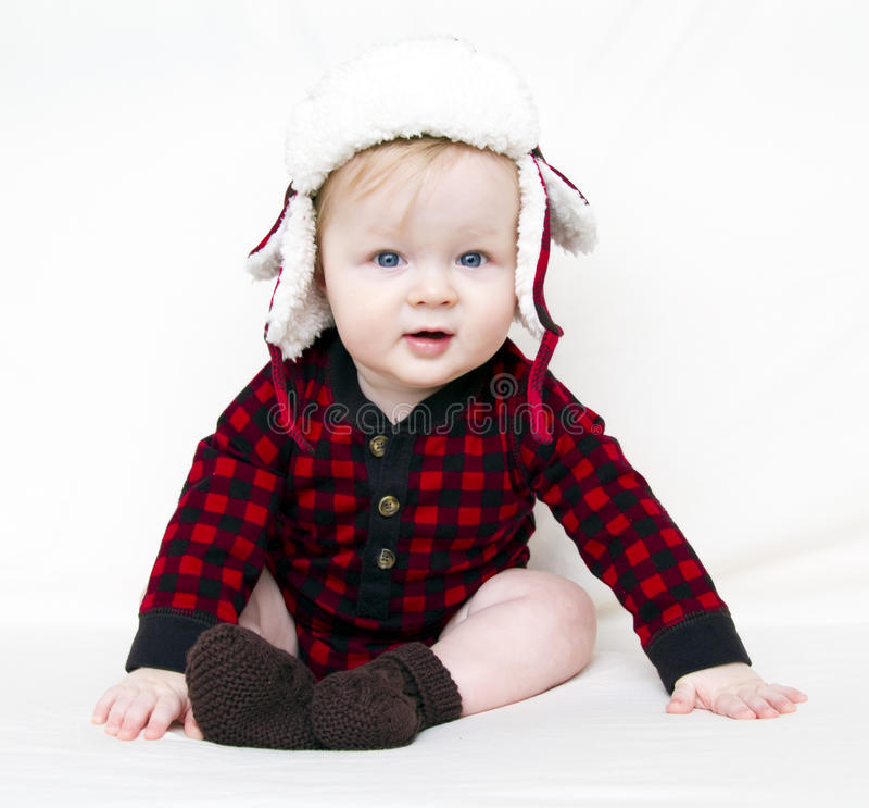 婴孩圣诞节帽子红色衬衣 免版税库存图片