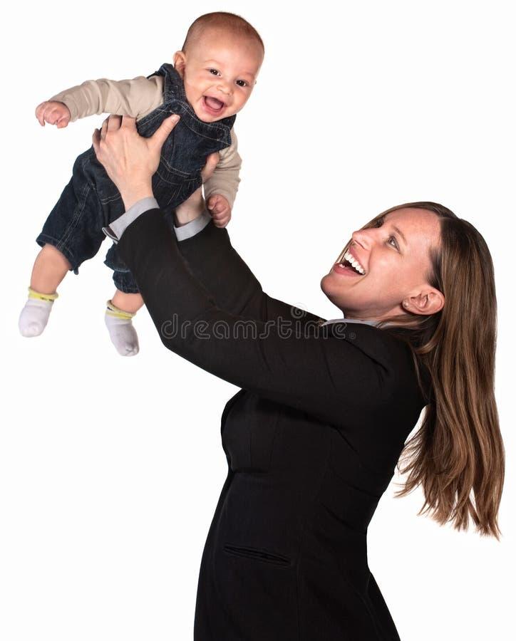 婴孩她推力职业妇女 免版税图库摄影