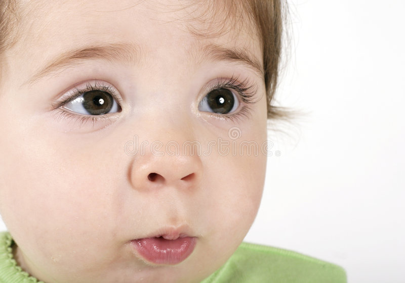 婴孩富有表情的面容 图库摄影